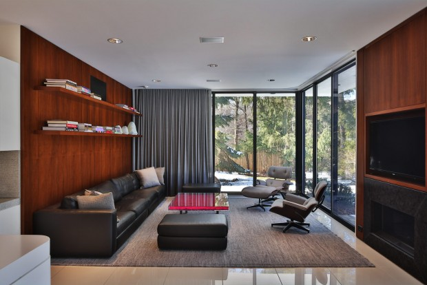 a beautiful ultra-modern living room surrounded by glass, built by berliant builders