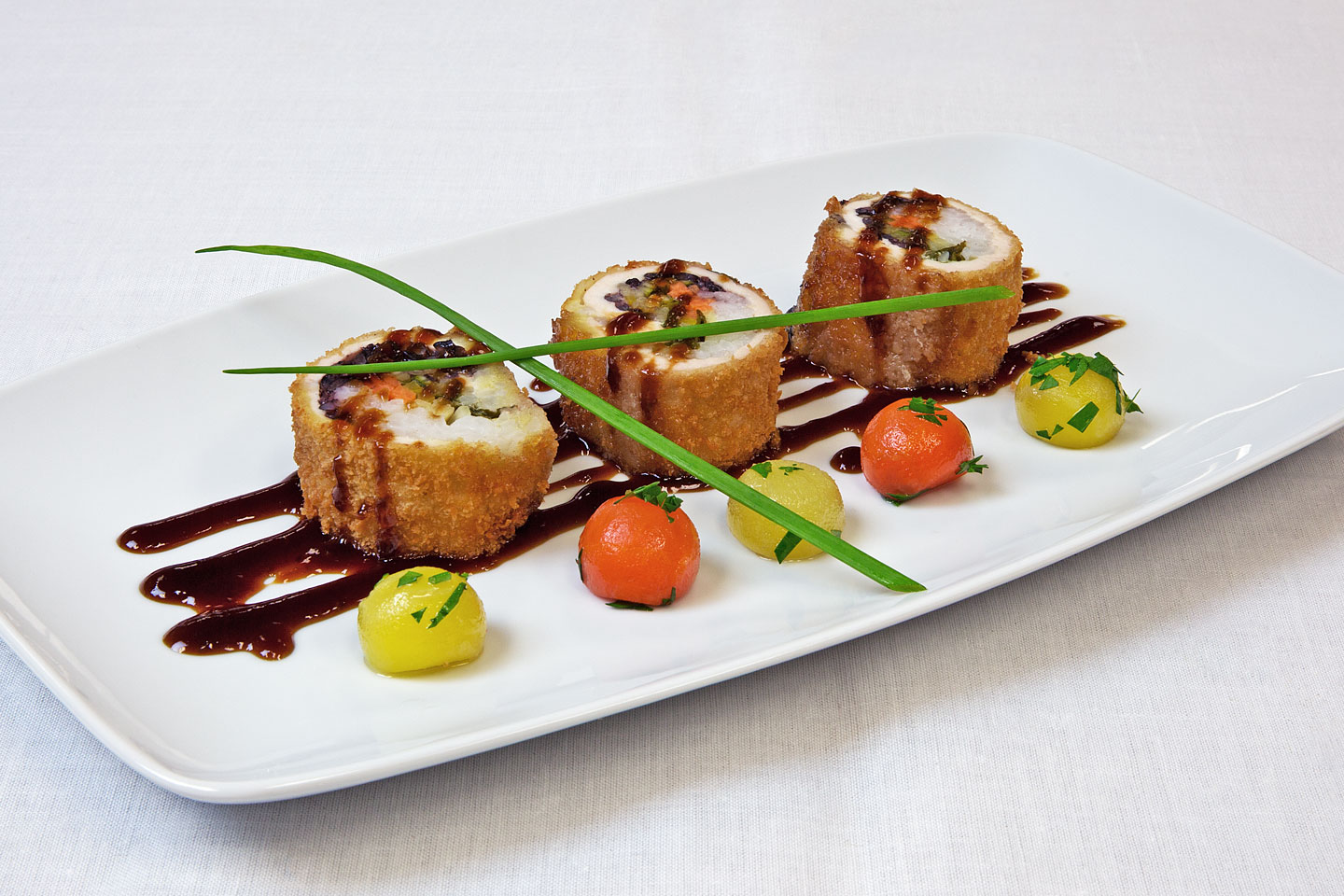 a delicious appetizer prepared by danziger kosher catering and served on a square oval porcelain plate