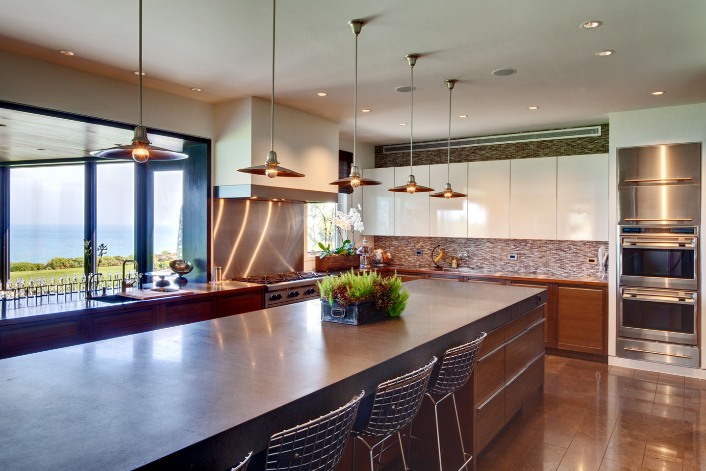 a large, modern, professional kitchen designed and built by berliant builders that has an amazing view