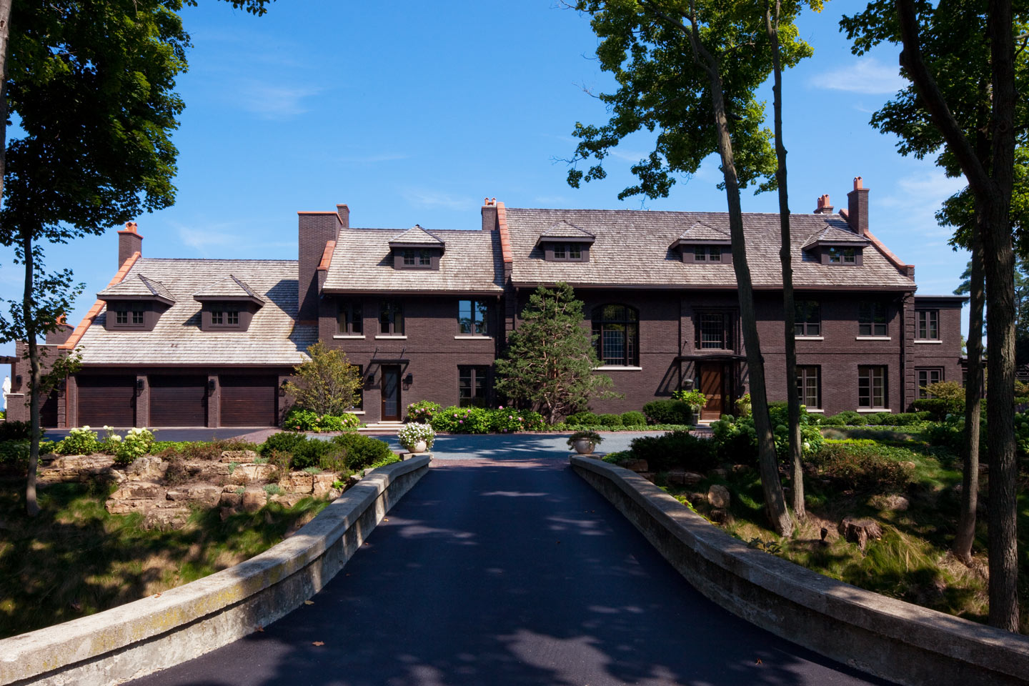 a front view looking up the driveway of a large estate property that berliant builders remodeled and built an addition at