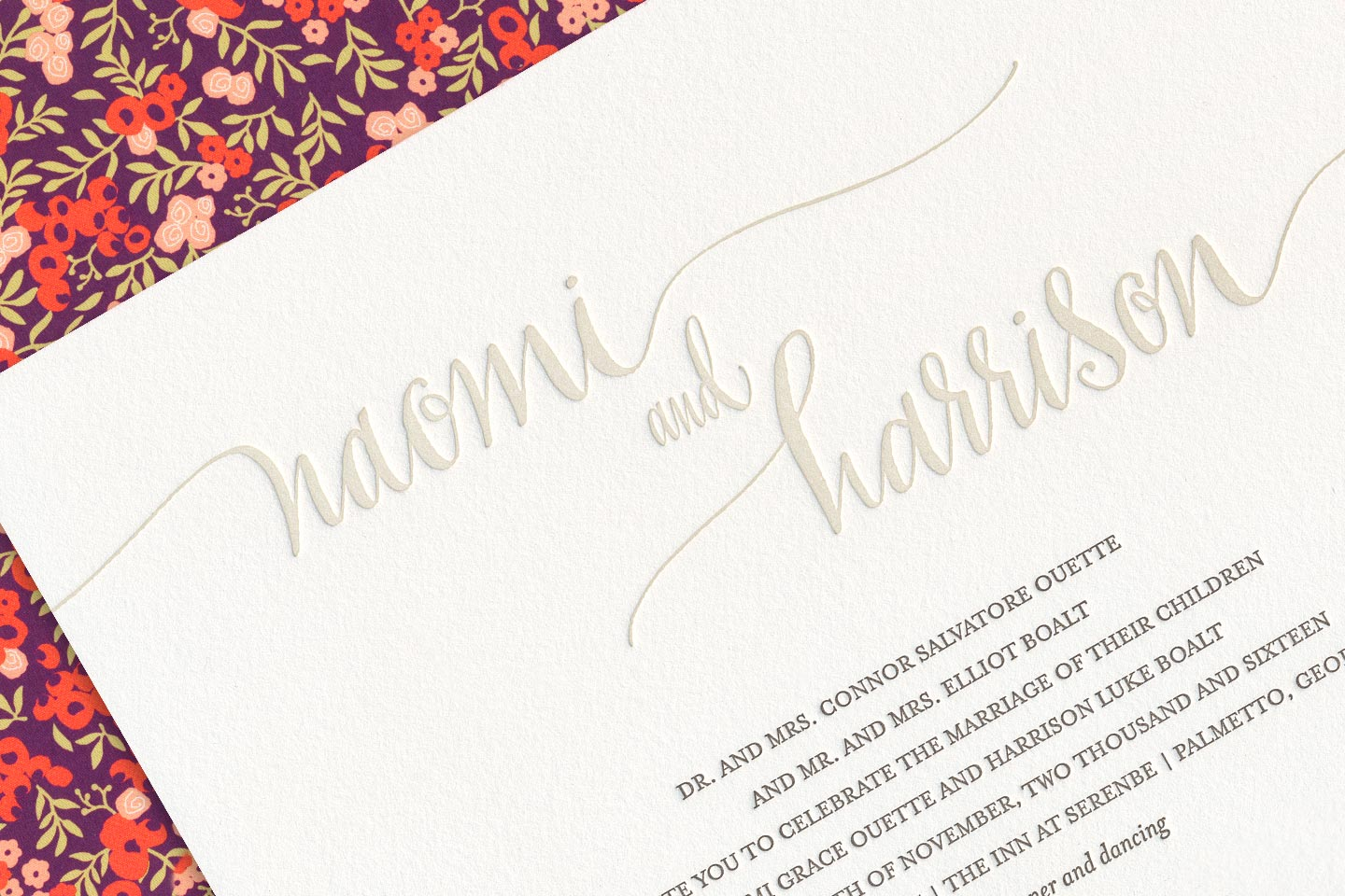 a beautiful sample wedding invitation for naomi and harrison, overlayed on top of its envelope featuring a beautiful floral print liner, captured by 4d, inc