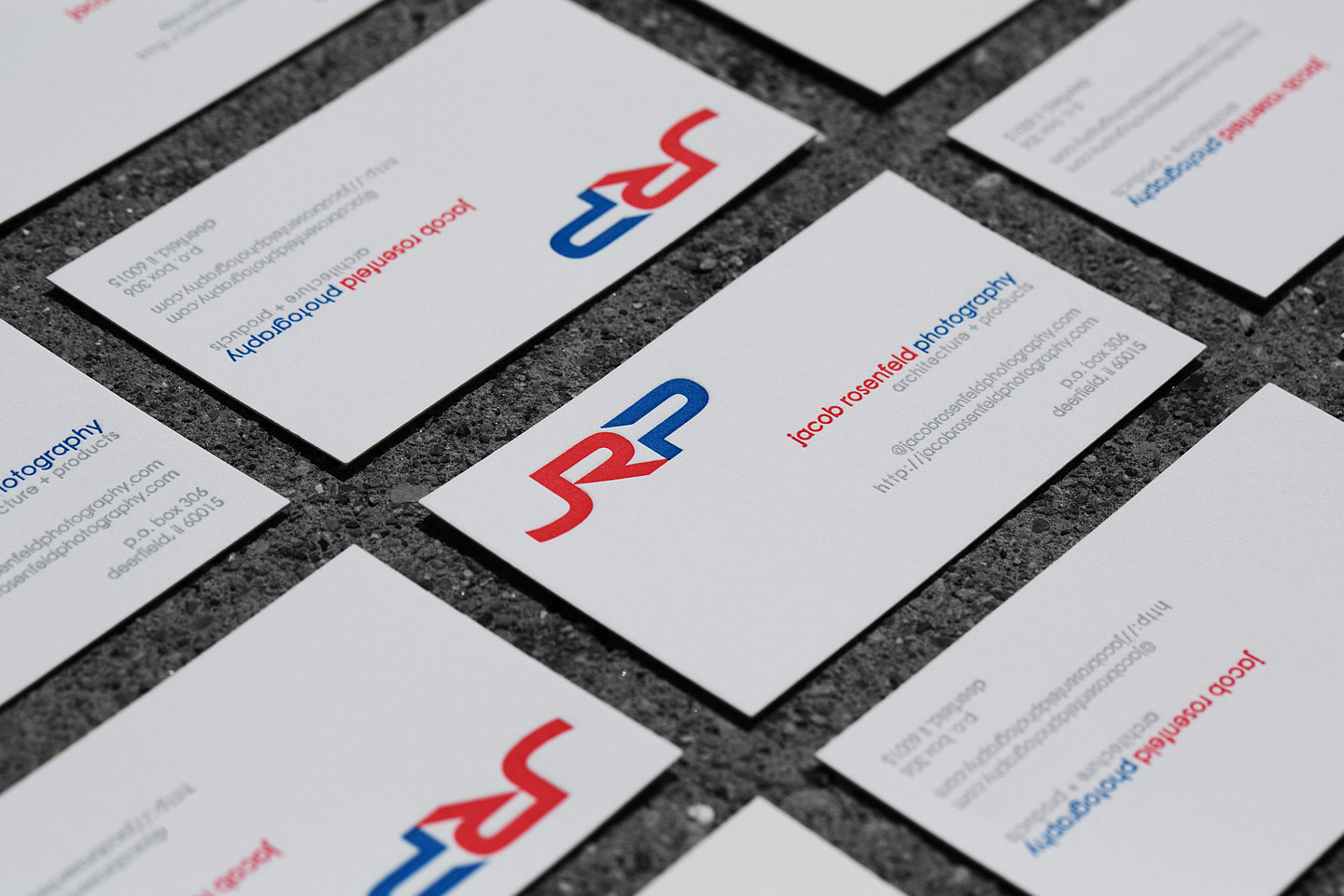 A large grouping of JRP letterpress business cards arranged in a grid